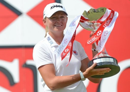 Stacy Lewis holds the trophy after winning the final round of the HSBC Women's Champions in Singapore on March 3, 2013