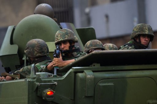 Brazilian marines' APCs leave the Caju shantytown in Rio de Janeiro, Brazil, on March 3, 2013