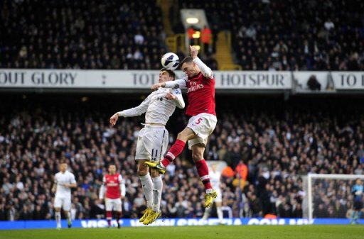 Tottenham Hotspur's Gareth Bale (L) vies with Arsenal's Thomas Vermaelen at White Hart Lane on March 3, 2013