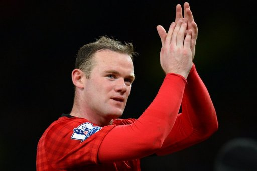Manchester United's Wayne Rooney acknowledges the crowd at Old Trafford on February 10, 2013