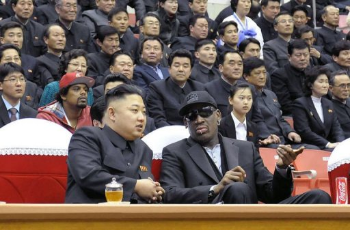 Kim Jong-Un (front L) and Dennis Rodman (front R) speaking at a basketball game in Pyongyang on February 28, 2013
