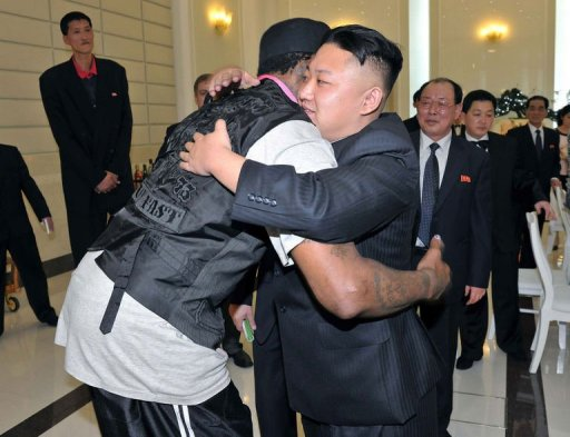 Kim Jong-Un (front R) hugging Dennis Rodman during a dinner in Pyongyang on March 1, 2013