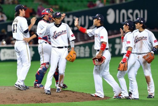 Japan's players celebrate after winning on March 3, 2013 in Fukuoka