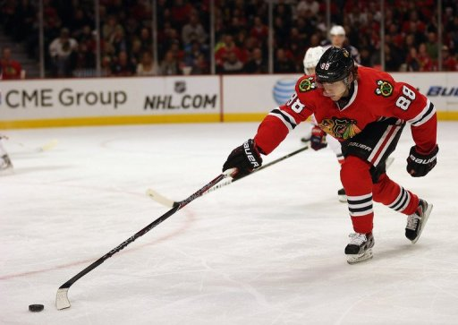 Patrick Kane of the Chicago Blackhawks chases down the puck on February 24, 2013 in Chicago, Illinois