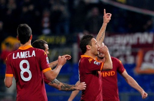 AS Roma's Francesco Totti celebrates after scoring on March 3, 2013 in Rome