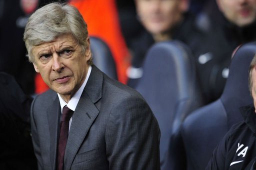 Arsenal manager Arsene Wenger looks on at White Hart Lane in north London on March 3, 2013