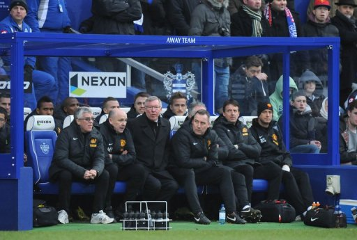 Manchester United's Alex Ferguson (3rd L) watches a match against Queens Park Rangers in London on February 23, 2013
