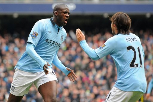Manchester City's Yaya Toure (L) and David Silva are pictured during their match against Chelsea on February 24, 2013