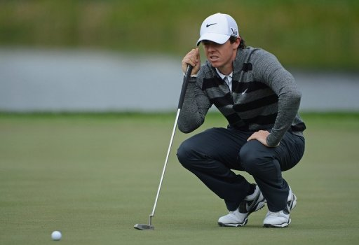World number one and defending champion, Rory McIlroy lines up a putt at the Honda Classic on March 1, 2013 in Florida
