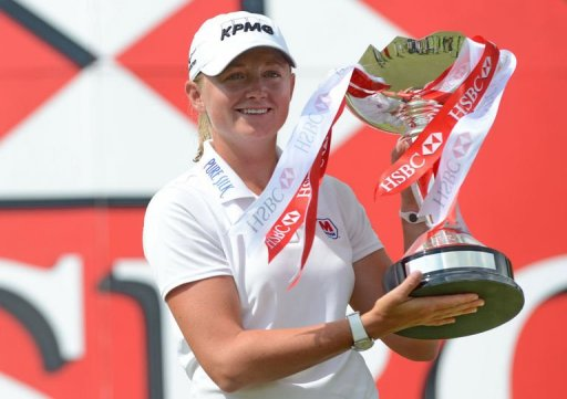 Stacy Lewis of the US poses with the trophy after winning the LPGA golf tournament in Singapore on March 3, 2013