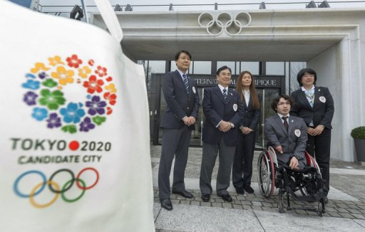 Members of the delegation of the Tokyo bid of the Japanese Olympic Committie pose in Lausanne on January 7, 2013