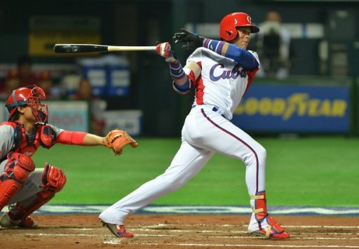 Jose Fernandez bats as China's catcher Meng Weiqiang looks on during their match in Fukuoka on March 4, 2013