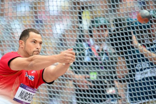 Koji Murofushi competes in the hammer throw qualifying rounds during the London 2012 Olympic Games on August 3, 2012