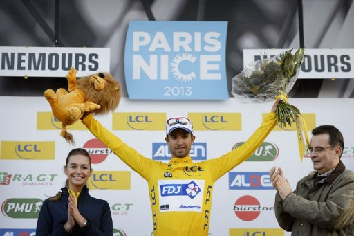 Nacer Bouhanni celebrates with his overall leader yellow jersey on the podium on March 4, 2013