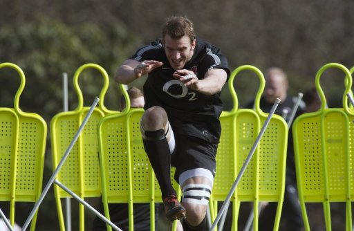 England's flanker Tom Croft jumps through obstacles during a training session in Bagshot on March 15, 2012