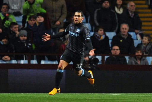 Manchester City's Carlos Tevez celebrates scoring in Birmingham on March 4, 2013