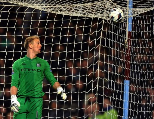 Manchester City goalkeeper Joe Hart eyes the ball over the net in Birmingham on March 4, 2013