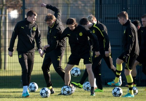 Dortmund's head coach Juergen Klopp (2nd L), seen with players during a training session in Dortmund, on March 4, 2013