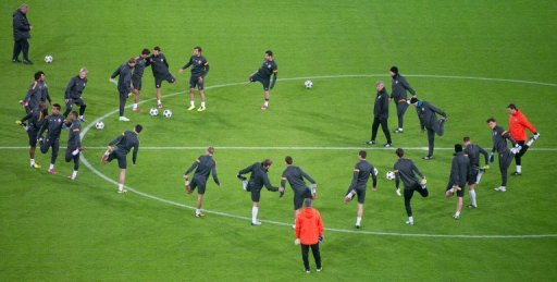 Donetsk's players warm up during a training session in Dortmund, on March 4, 2013