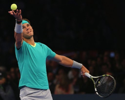 Rafael Nadal serves during an exhibition match against Argentina's Juan Martin Del Potro in New York on March 4, 2013