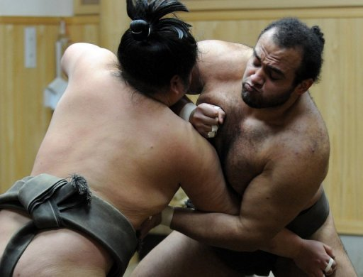 Osunaarashi of Egypt (R) and Genkaiho are pictured on February 14, 2013 during training at a sumo stable in Tokyo