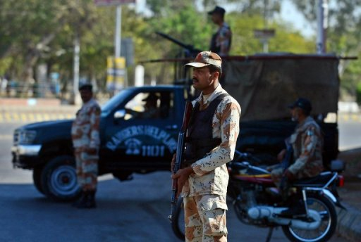 Pakistani paramilitary soldiers stand guard in Karachi on March 4, 2013, the day following a car bomb attack in the city