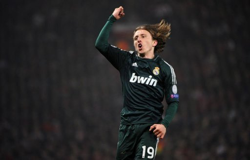 Real Madrid's Luka Modric celebrates scoring at Old Trafford in Manchester on March 5, 2013