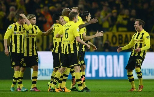 Dortmund's Mario Goetze (R) celebrates with his teammates after scoring in Dortmund on March 5, 2013