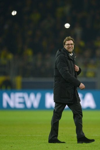 Dortmund's Juergen Klopp smiles in Dortmund on March 5, 2013