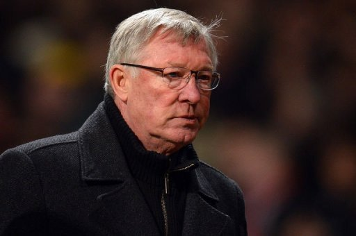 United manager Alex Ferguson leaves the field at half time in Manchester on March 5, 2013