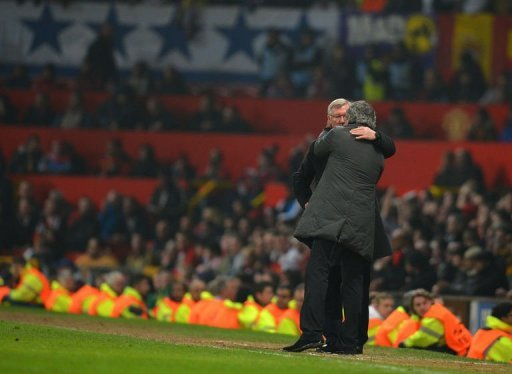 Alex Ferguson (L) and Jose Mourinho embrace towards the end of the UEFA Champions League match on March 5, 2013