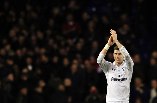 Tottenham Hotspur's Gareth Bale thanks the fans at White Hart Lane in north London on March 3, 2013