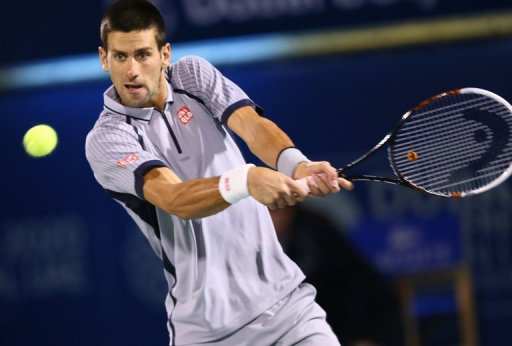 Novak Djokovic returns the ball during a match at ATP Dubai Open, in the Gulf emirate, on March 2, 2013