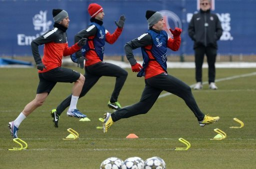 PSG's (from L) Jeremy Menez, Javier Pastore and Maxwell, seen during a training session in Paris on March 5, 2013