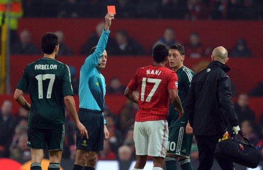 Cuneyt Cakir shows Nani the red card during the UEFA Champions League clash at Old Trafford on March 5, 2013