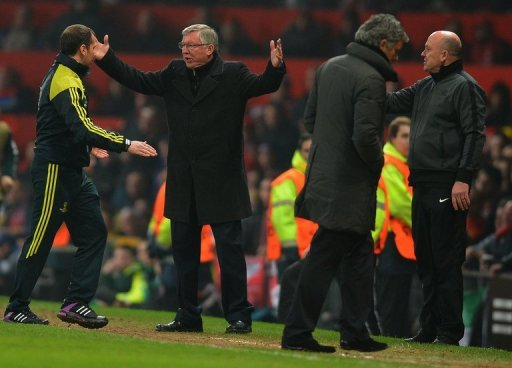 Manchester United manager Alex Ferguson berates the fourth official after seeing Nani sent off, on March 5, 2013