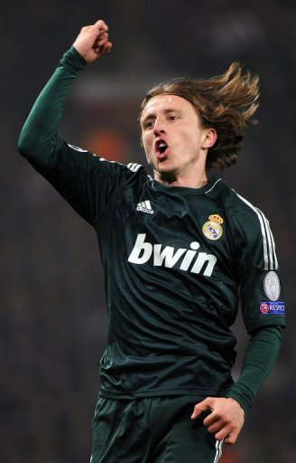 Real Madrid midfielder Luka Modric celebrates scoring the equaliser against Manchester United on March 5, 2013