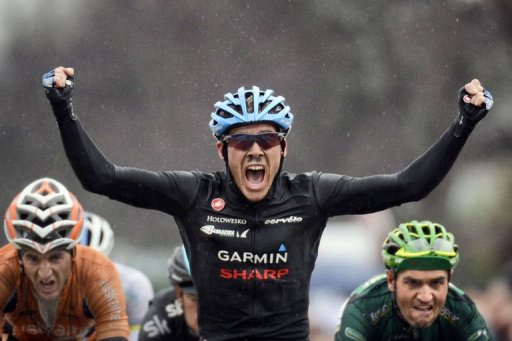 Team Garmin-Sharp's US cyclist Andrew Talansky celebrates as he crosses the finish line on March 6, 2013