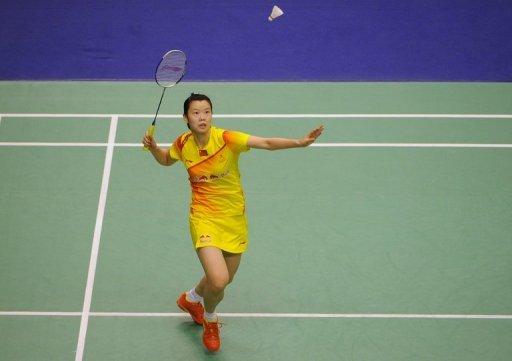 Li Xuerui of China hits a shot at the Hong Kong Open badminton tournament on November 24, 2012
