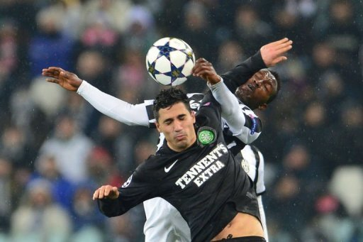 Celtic's Beram Kayal fights for the ball with Juventus' Kwadwo Asamoah (back) on March 6, 2013 in Turin
