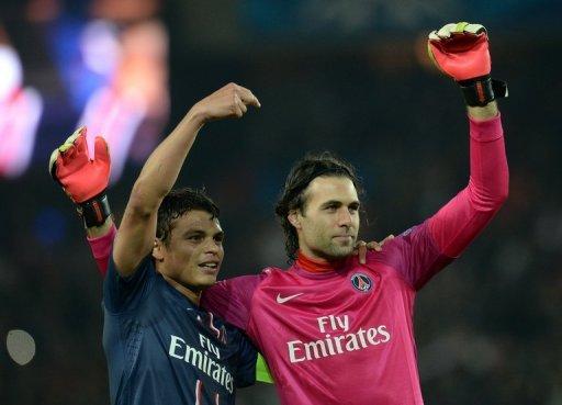 Paris Saint-Germain's Salvatore Sirigu (R) and Thiago Silva celebrate on March 6, 2013 in Paris