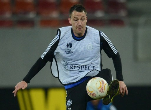 John Terry takes part in a training session on March 6, 2013, the eve of the Europa League clash at Steaua Bucharest