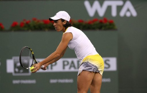 Francesca Schiavone serves to Flavia Pennetta at the BNP Paribas Open on March 6, 2013
