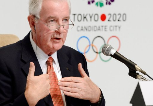 Craig Reedie answers questions during a press conference in Tokyo on March 7, 2013