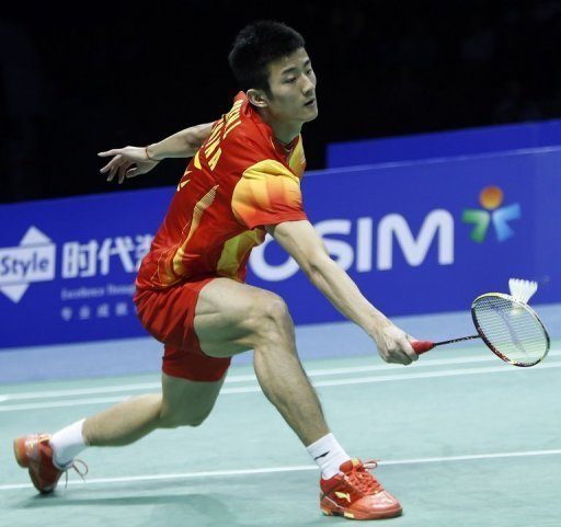 Chen Long of China returns a shot on December 16, 2012