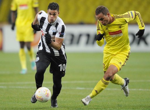 Newcastle's Hatem Ben Arfa (L) vies with Anji's Ewerton at Stadion Luzhniki in Moscow on March 7, 2013