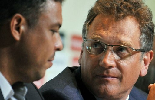 Jerome Valcke (R) and Ronaldo Nazario attend a press conference in Rio de Janeiro, Brazil, on March 7, 2013