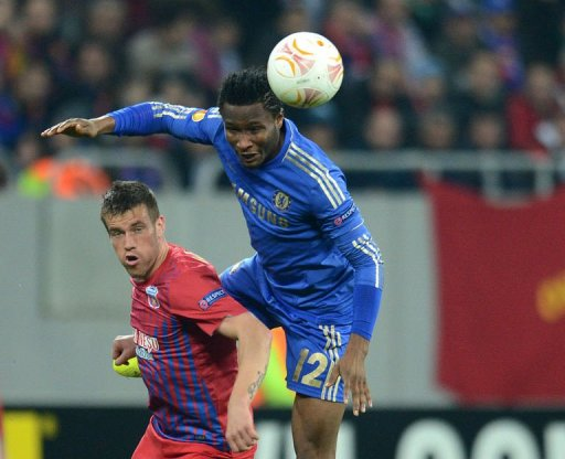John Obi Mikel (R) of Chelsea fights for the ball with Mihai Doru Pintilii (L) of Steaua Bucharest on March 7, 2013