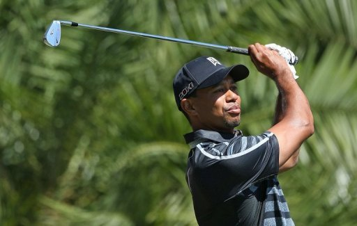 Tiger Woods hits his tee shot on the 15th hole on March 7, 2013 at the Trump Doral Golf Resort & Spa in Miami, Florida