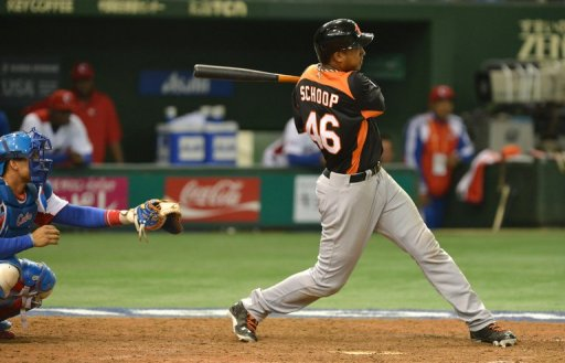 Netherlands' Jonathan Schoop bats as Cuba's catcher Frank Morejon looks on at Tokyo Dome on March 8, 2013